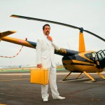 VKStandingInFrontOfHelicopterGoldBriefcase