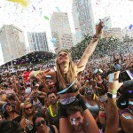 Alina Baum, 24, from Germany dances as confetti sprinkles the crowd during the third day of Ultra Music Festival on Sunday, March 26, 2017 in downtown Miami, Fla. (Matias J. Ocner/Miami Herald/TNS via Getty Images)